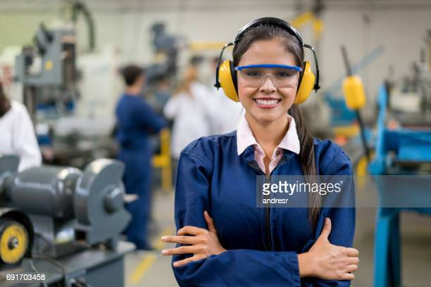 portrait of an engineering female student in class - ear protection stock pictures, royalty-free photos & images