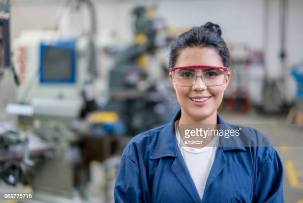 portrait of an engineering student in a workshop - engineering stock pictures, royalty-free photos & images