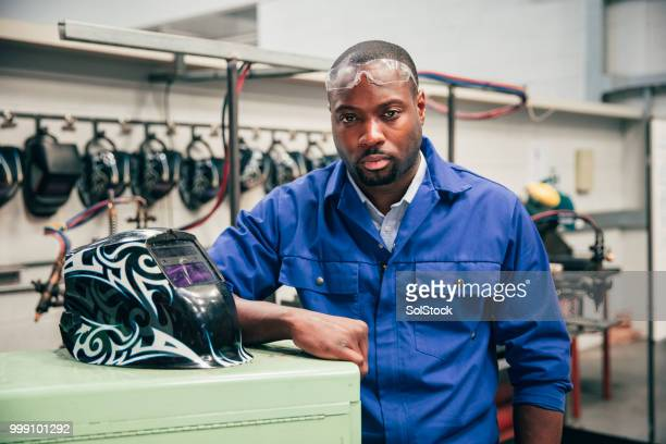 portrait of an engineering student - black jumpsuit stock photos and pictures