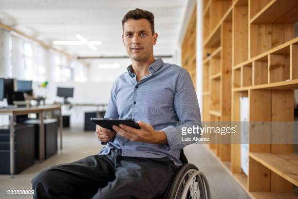 portrait of an entrepreneur sitting on wheelchair - 40 49 years stock pictures, royalty-free photos & images