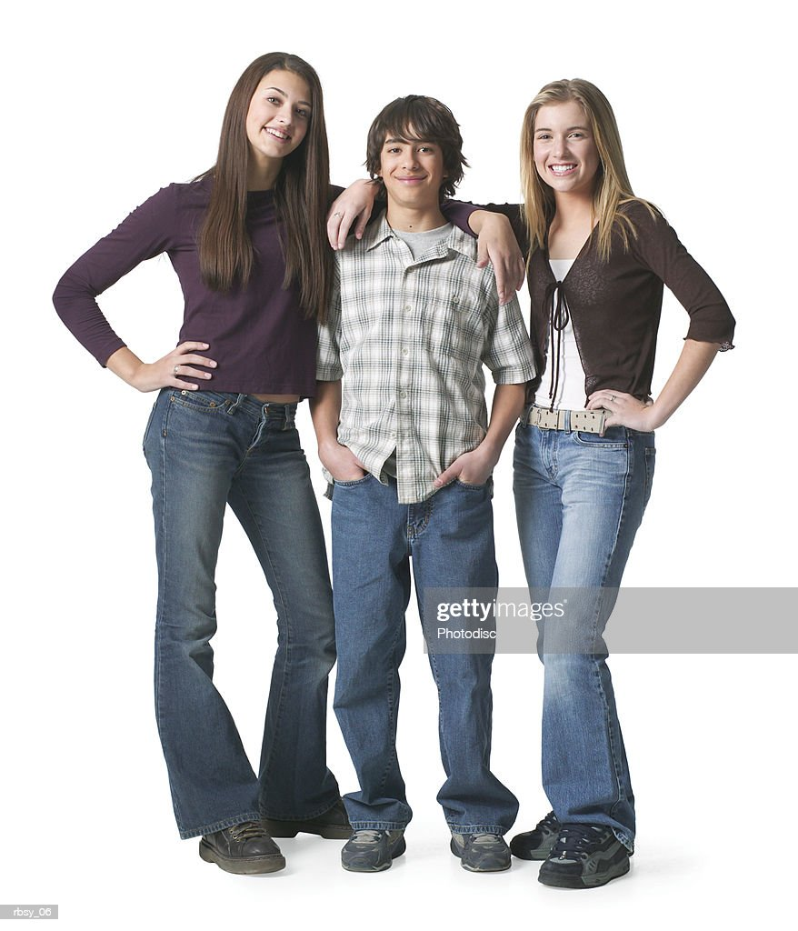 portrait of an ethnic teenage boy as he stands between two of his teenage female friends : Foto de stock