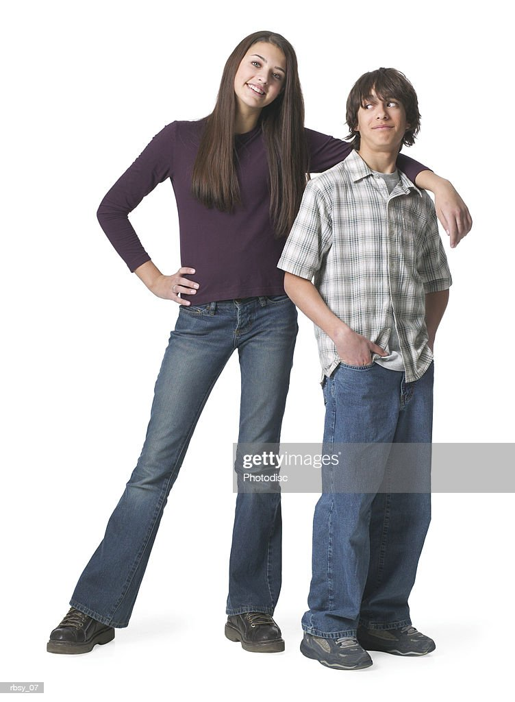 portrait of an ethnic teenage couple as the girl places her arm around the boy : Foto de stock