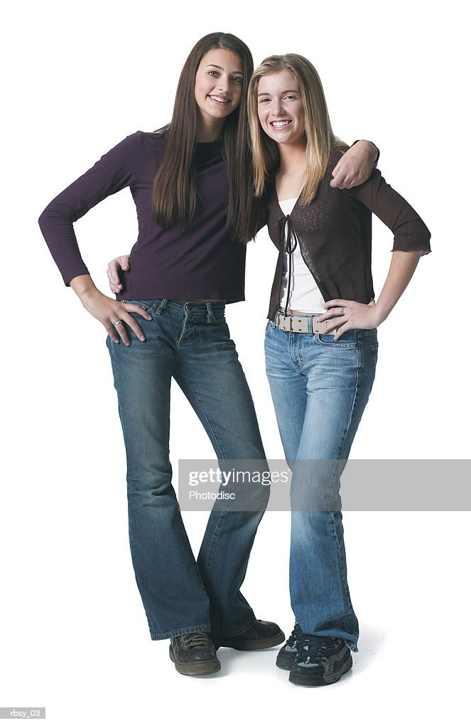 portrait of an ethnic teenage girl as she puts her arm around her blonde caucasian teenage female friend : Stockfoto