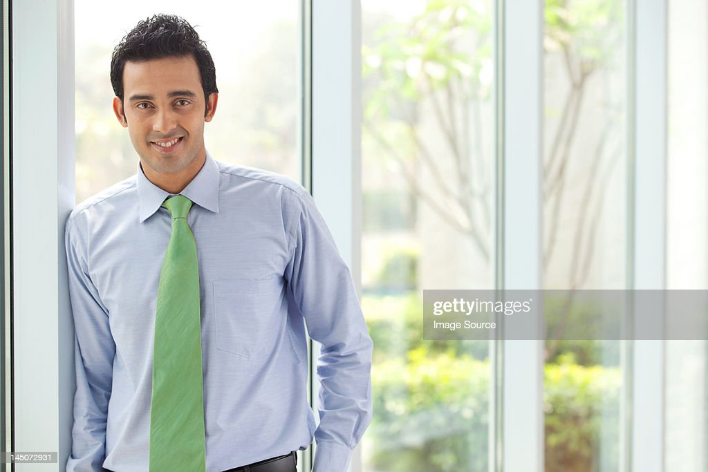 Portrait of an executive smiling : ストックフォト