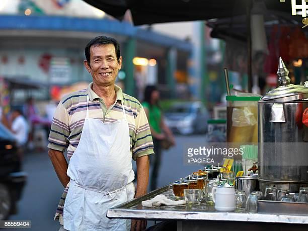 A portrait of an herbal tea vendor