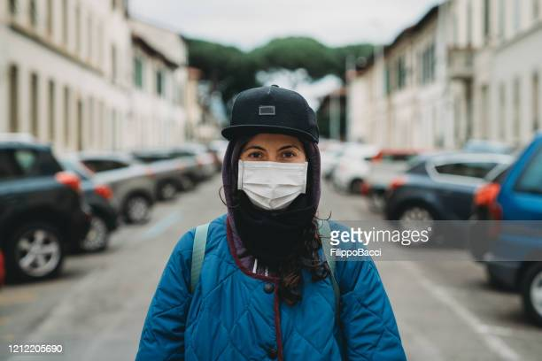 portrait of an hip young girl in the city with a flu mask - headwear stock pictures, royalty-free photos & images