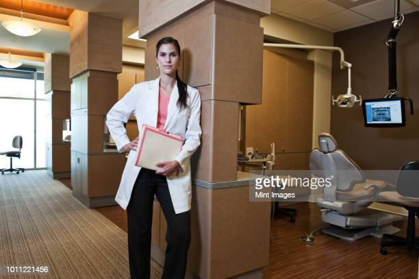 Portrait of an Hispanic dentist in her dental office.