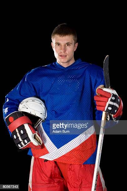 portrait of an ice hockey player - ice hockey uniform stock pictures, royalty-free photos & images