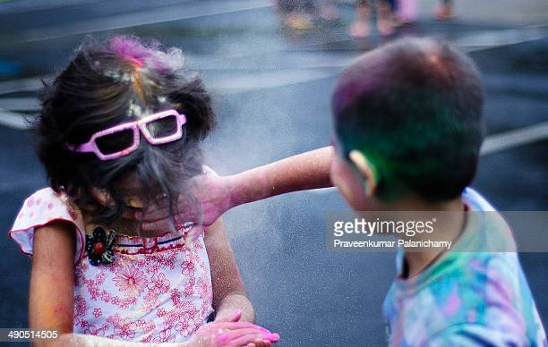 CONTENT] Portrait of an Indian girl child playing holi Holi is a spring festival also known as the festival of colours and the festival of love It is...