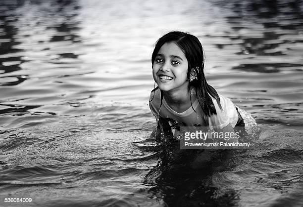 Portrait of an Indian girl child playing in a lake