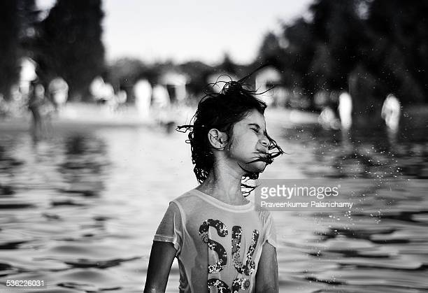 portrait of an indian girl child playing in a lake - black and white instant print stock pictures, royalty-free photos & images