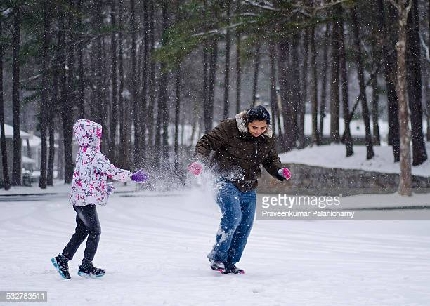 Portrait of an Indian girl child throwing snowball