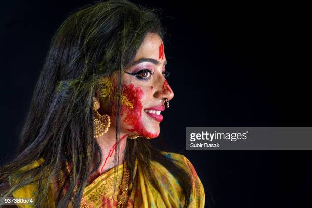 Portrait of an Indian woman celebrating holi festival.