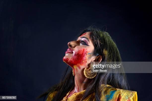 Portrait of an Indian woman celebrating Holi.