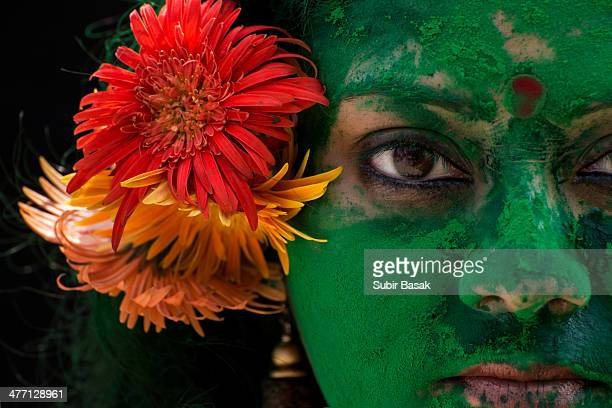 Portrait of an Indian woman during Holi festival .