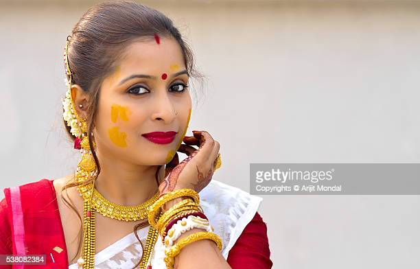 Portrait of an Indian woman with gold jewellery and Turmeric also called Haldi