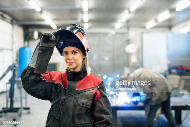 portrait of an industrial woman worker at the factory. - metal industry stock pictures, royalty-free photos & images