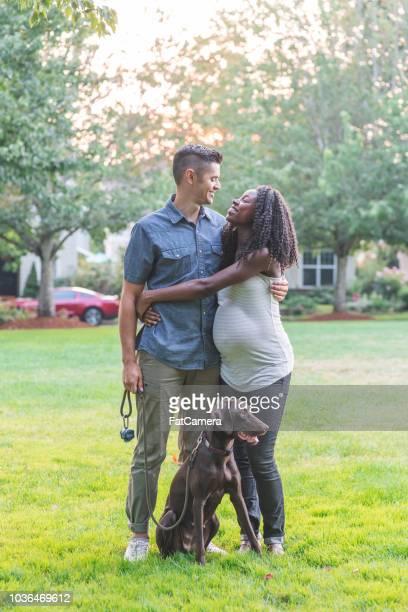 beautiful mixedrace pregnant couple takes their