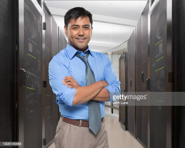 portrait of an it manager in a server room - john lund stock pictures, royalty-free photos & images