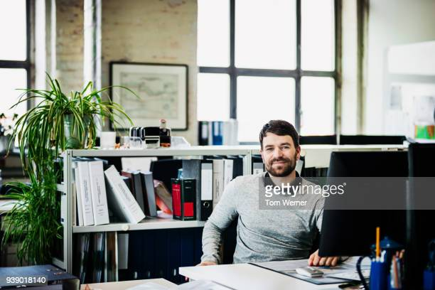 Portrait Of An Office Worker At His Desk