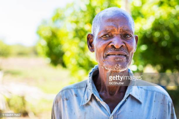 portrait of an old african farmer - one senior man only stock pictures, royalty-free photos & images