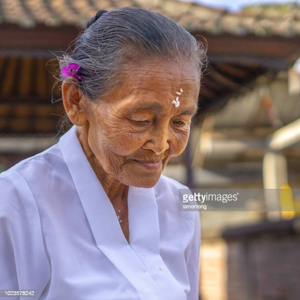 portrait of an old balinese lady - bindi stock pictures, royalty-free photos & images