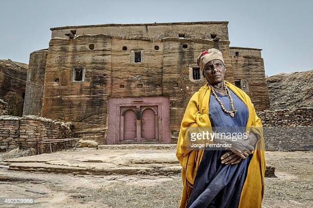 Portrait of an old Ethiopian nun in front of a church