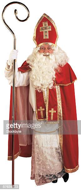 portrait of an old man dressed as a bishop holding a staff