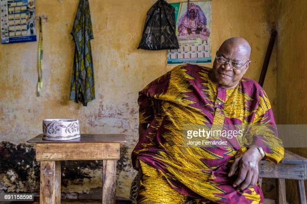Portrait of an old man dressed with a traditional colorful robe
