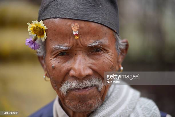 A Portrait of an old man in a traditional attire arrive to offer ritual prayer in Temple at Thimi Bhaktapur Nepal on Saturday April 07 2018