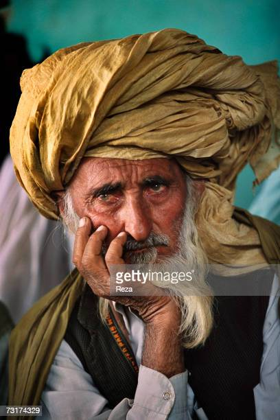 Portrait of an old Pashtun of the Waziri tribe on the border of Pakistan in the Pashtun tribal zone of Waziristan on July 2004 in Afghanistan