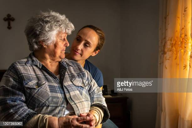 portrait of an old portuguese woman with her daughter. - traditionally portuguese stock pictures, royalty-free photos & images