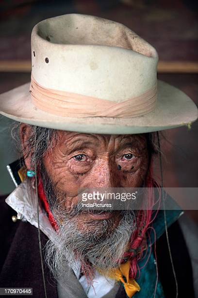 Portrait of an old Tibetan man Tibet