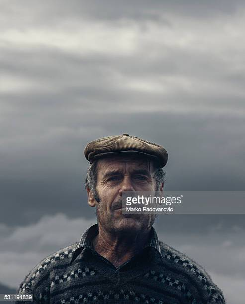 portrait of an old village man from serbia - flat cap stock pictures, royalty-free photos & images