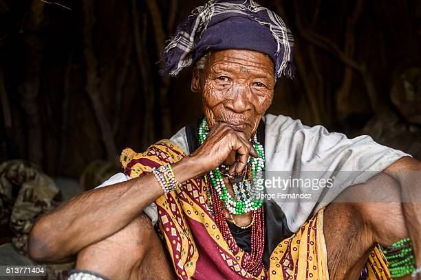 Portrait of an old woman from the bushmen tribe inside her hut in a remote part of the Kalahari desert