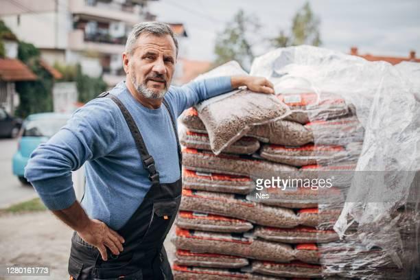 portrait of an older proud worker - grânulo imagens e fotografias de stock