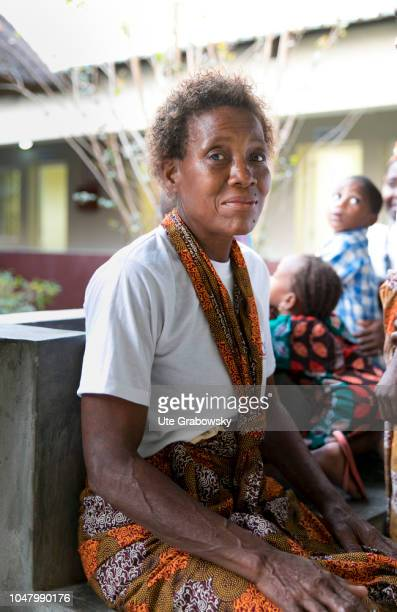 Portrait of an older woman in the women's shelter for people suffering from AIDS on August 26 2018 in Beira Mozambique Children can be seen in the...