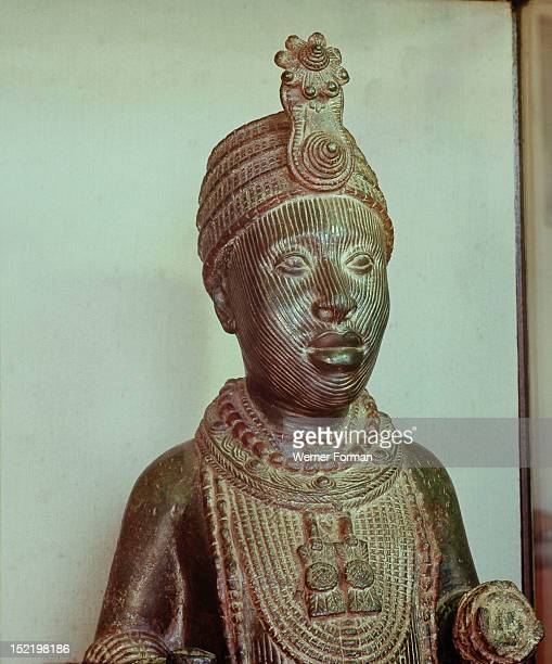 A portrait of an Oni wearing the traditional regalia a crown a beaded collar and heavy beads Nigeria Ife late 15th / early 16th century Wunmonije...