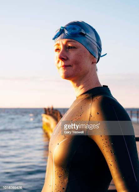 Portrait of an open water swimmer looking out to sea