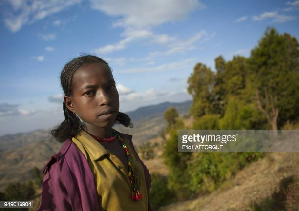 Portrait of an oromo tribe girl with stranded hair and pearl necklace dire dawa Ethiopia on January 9 2012 in Dire Dawa Ethiopia