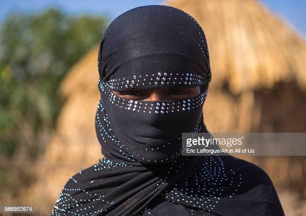 Portrait of an oromo woman with face covered amhara region artuma Ethiopia on February 21 2016 in Artuma Ethiopia