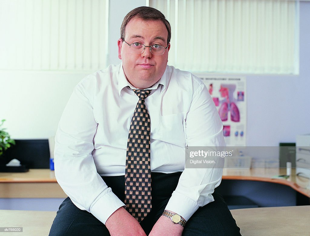 Portrait of an Overweight Businessman in a Doctor's Office : Stockfoto
