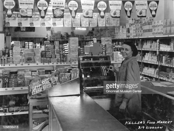 Portrait of an undientified cashier at Keller's Food Market , Cincinnati, Ohio, late 1930s.