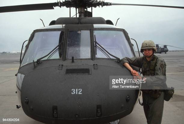 Portrait of an unidentified American military pilot as she poses on the tarmac beside to her helicopter during the Gulf War Kuwait 1991