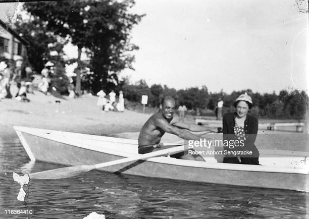 Portrait of an unidentified couple in a rowboat near the shore of Idlewild Lake Idlewild Michigan September 1938 Idlewild known as 'the Black Eden'...