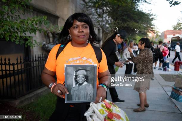 Portrait of an unidentified demonstrator as she holds a photograph of a victim of gun-related crimes, during an End Gun Violence rally, Washington...