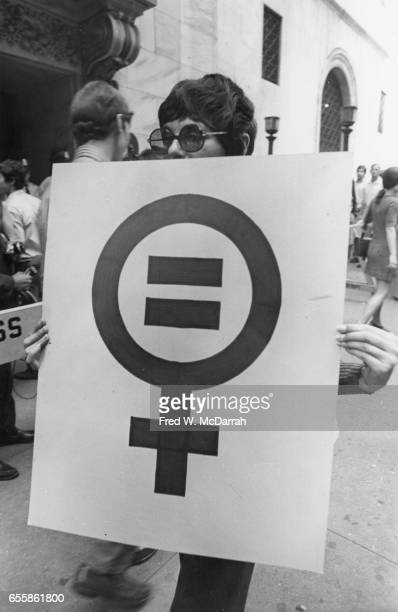 Portrait of an unidentified demonstrator poses with a sign during the Women's Strike for Equality March New York New York August 26 1970 Her sign...