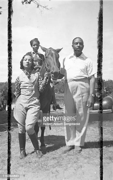 Portrait of an unidentified family as they pose with a horse Idlewild Michigan September 1938 Idlewild known as 'the Black Eden' was a resort...