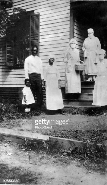 Portrait of an unidentified family where the mother had died from flurelated causes as they are visited by a trio of American Red Cross workers...
