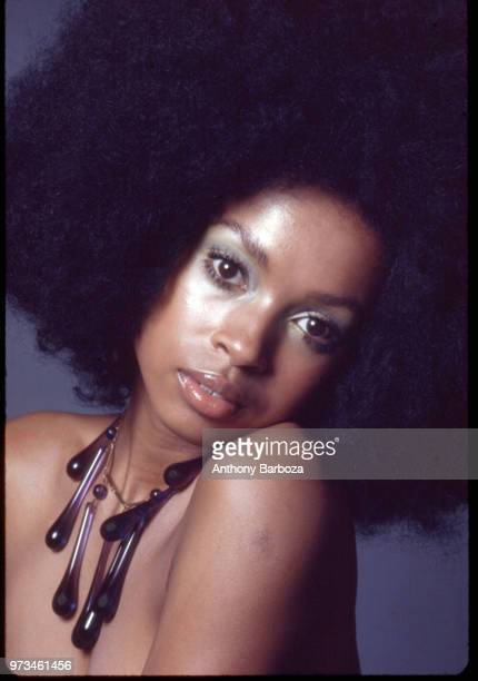 Portrait of an unidentified female model with an oversize necklace and an Afro hairstyle New York 1968
